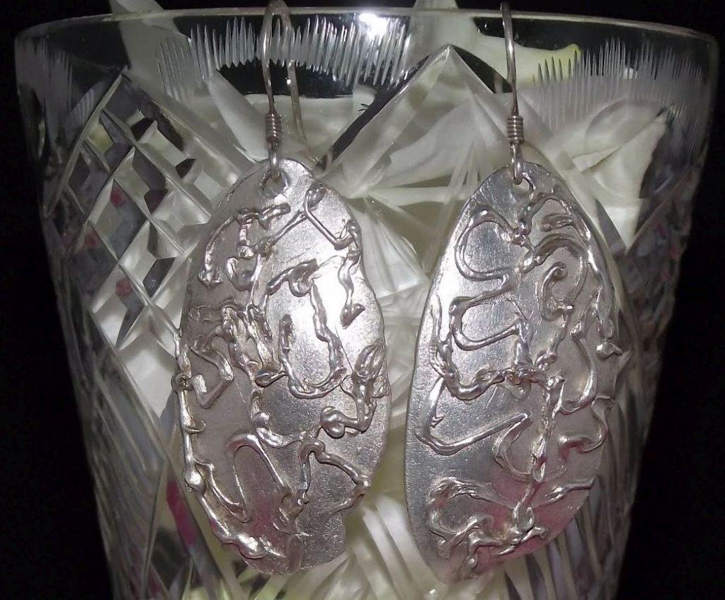 Silver earrings   Jewels of all kind
